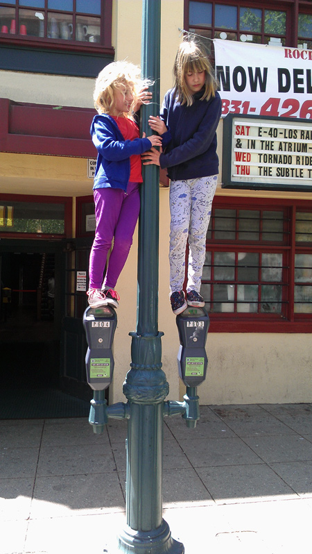 Standing on top of parking meters Pacific Avenue Downtown Santa Cruz